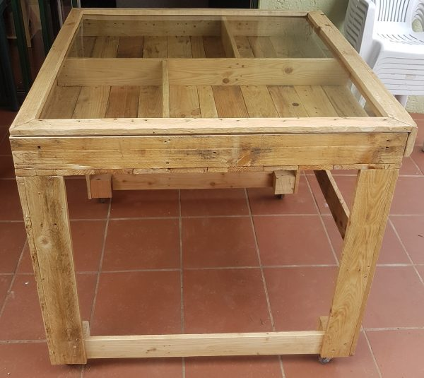 Table with storage compartments, on wheels